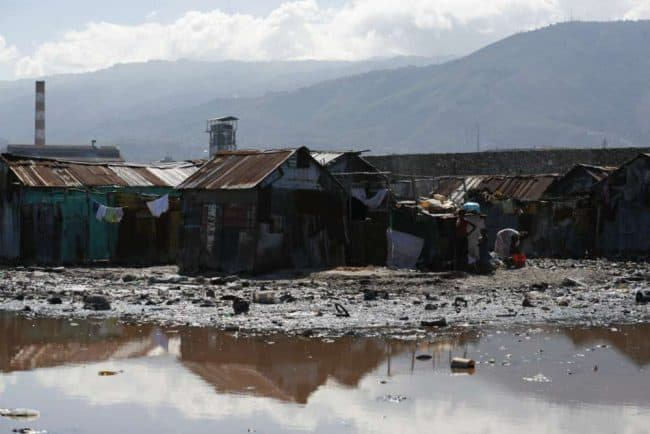 Flimsy shacks in Cite Soleil - a dump